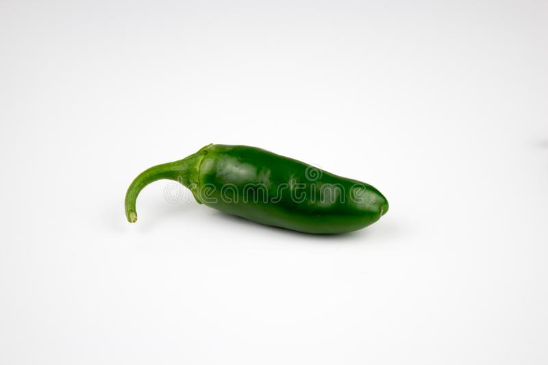Fresh, healthy jalapeno pepper from my garden. Background, multiple uses is possible royalty free stock image