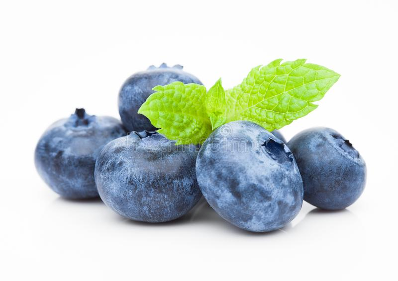 Fresh healthy organic blueberry with mint leaf stock photos