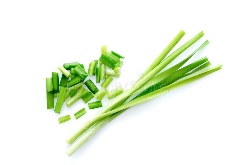 Fresh healthy organic green vegetable garlic chives, chinese chive sliced, green herb isolated on white background.  royalty free stock photos