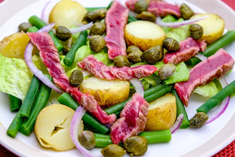 Fresh Healthy Rare Beef Steak Salad. With Capers, Boiled Potatoes, Green Beans and Red Onions royalty free stock images