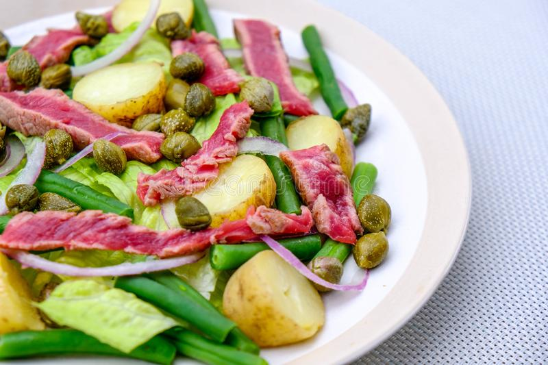 Fresh Healthy Rare Beef Steak Salad. With Capers, Boiled Potatoes, Green Beans and Red Onions stock photos