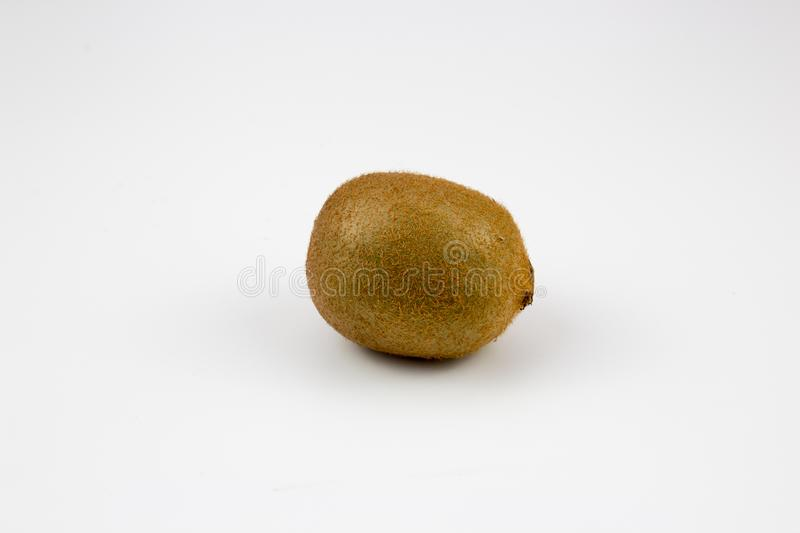 A kiwi fruits on background. A fresh, healthy, ripe kiwi fruits on white background. multiple uses are possible stock image