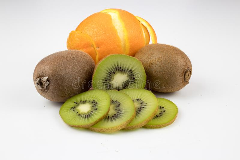 Kiwi and orange on background. Fresh, healthy, ripe kiwi and orange on white background. multiple uses are possible royalty free stock photo