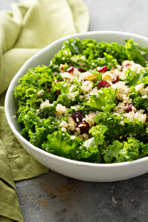 Fresh healthy salad with kale and quinoa royalty free stock photography