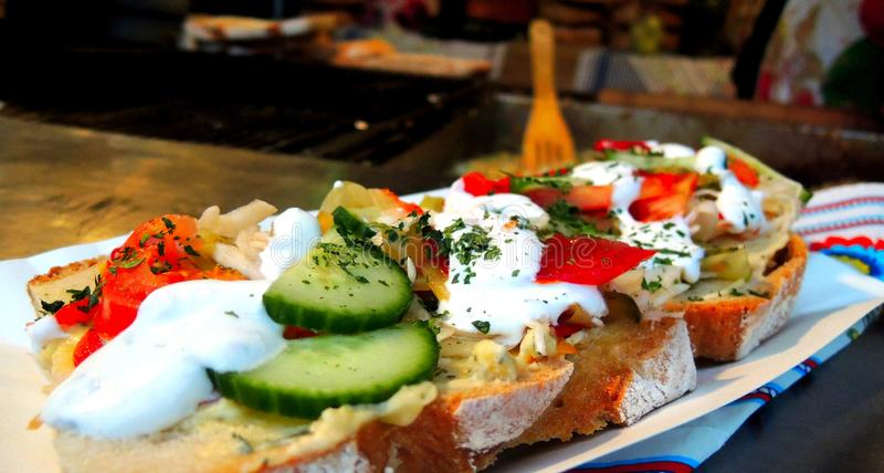 Fresh and healthy sandwich. Fresh sandwich with vegetables and dip on crisp bread stock photo