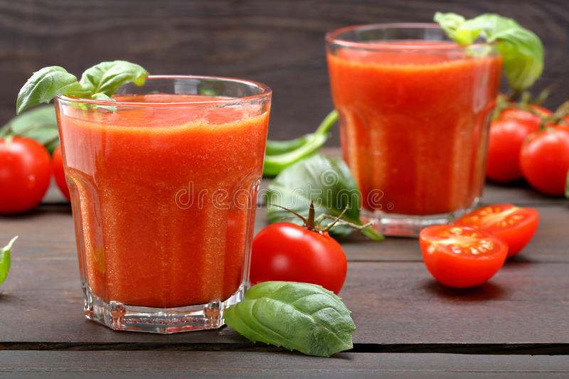 Fresh healthy tomato smoothie juice on wooden background royalty free stock photos
