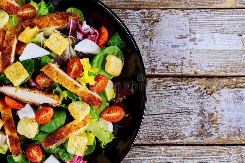 Fresh healthy vegetable salad grilled chicken in bowl, top view royalty free stock photography
