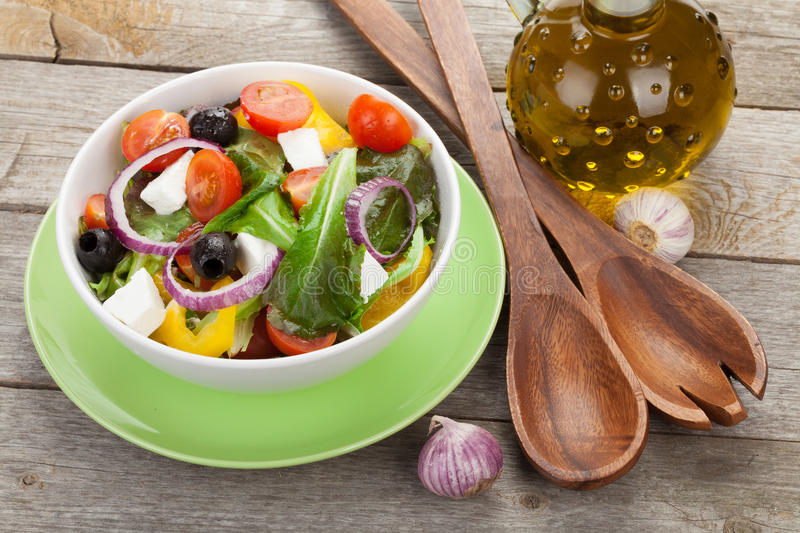 Fresh healty salad and kitchen utensils stock images