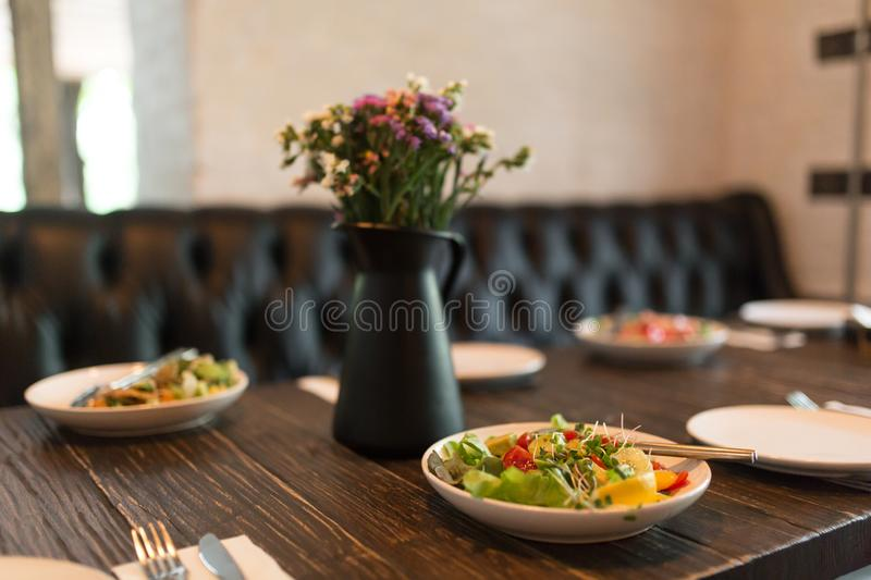Fresh healty salad plate on wooden table royalty free stock photography