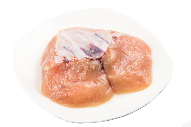 Fresh heart shaped skinless chicken breast meat with keel bone royalty free stock image