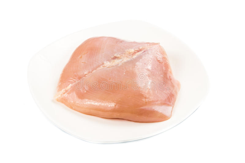 Fresh heart shaped skinless chicken breast meat on a plate.  stock photography