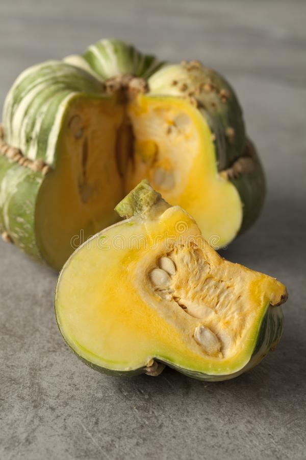 Fresh heirloom green Turban squash. And a slice stock photography