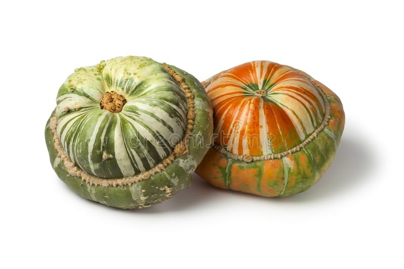 Fresh heirloom orange and green Turban squashes. On white background royalty free stock images