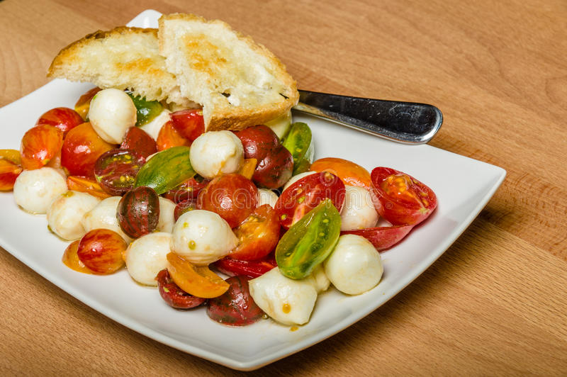 Fresh heirloom tomatoes with cheese royalty free stock photo