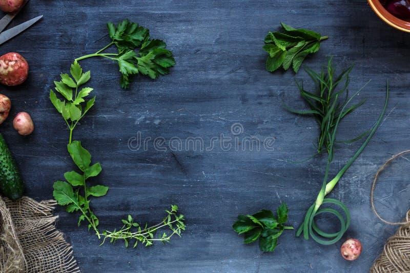 Fresh herbs frame on dark background, top view stock photos