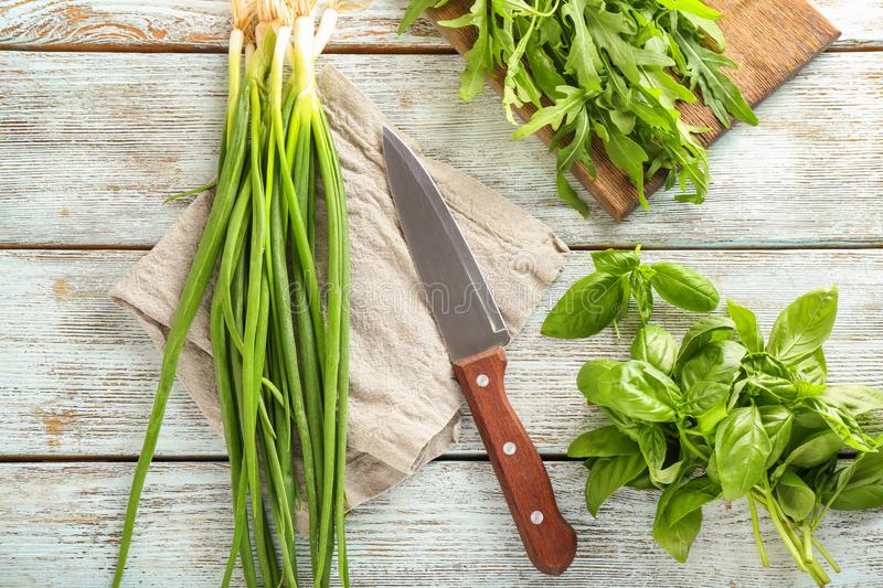 Fresh herbs with knife on wooden background royalty free stock photo