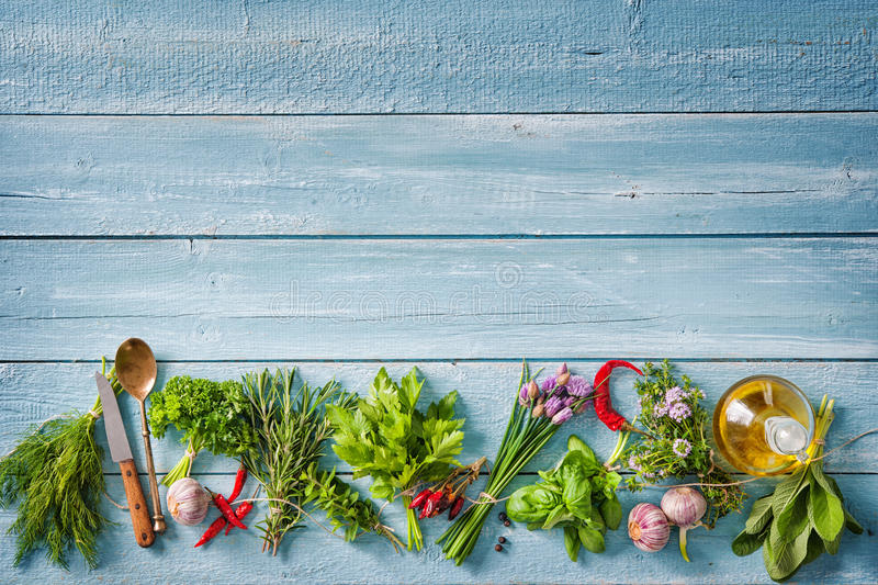 Fresh herbs and spices on wooden table stock images
