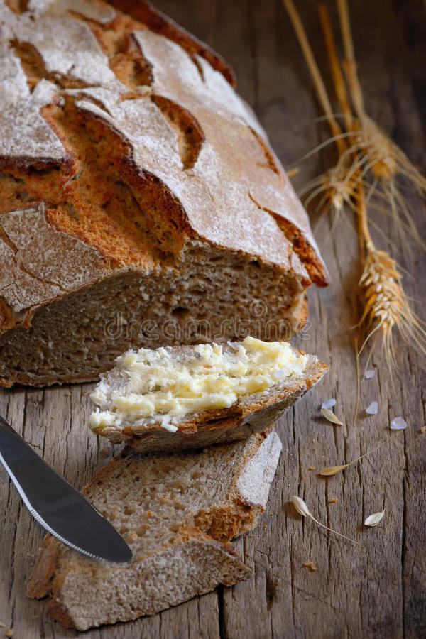 Fresh Home made Bread and butter. On old wooden table royalty free stock photography