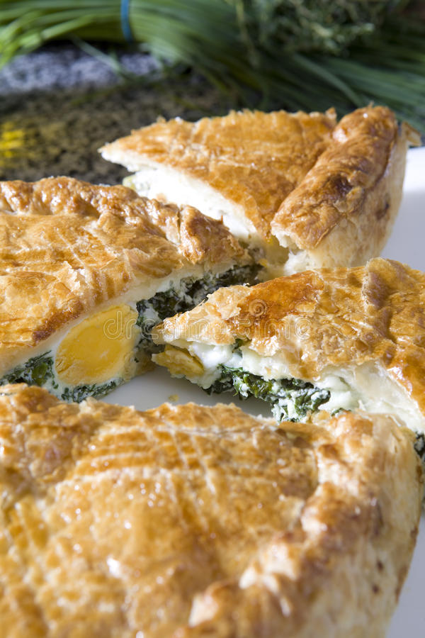 Fresh home made spinach and artichoke pie. On a plate royalty free stock photo