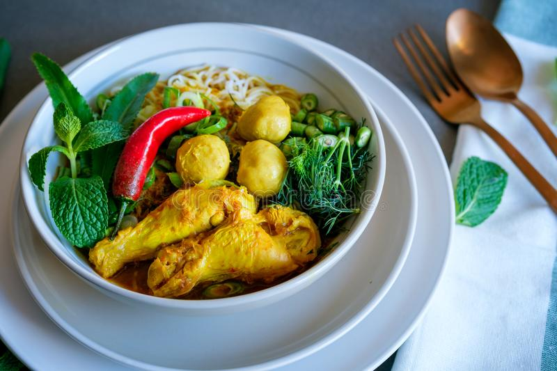 A fresh home made Thai rice noodles with herbs and chicken soup. stock images