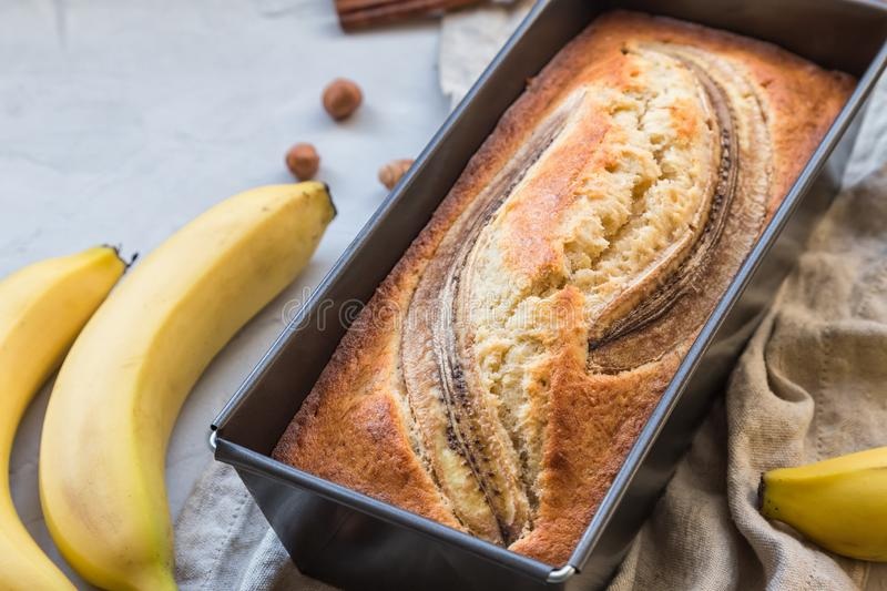 Fresh homemade banana bread in baking form royalty free stock images