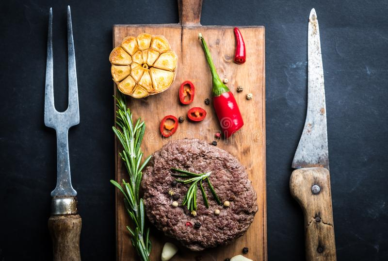 Fresh homemade beef burger cutlet on cooking board royalty free stock images