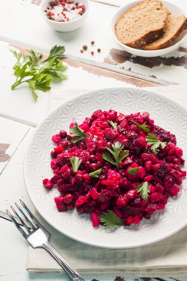 Fresh homemade Beetroot salad Vinaigrette in a white bowl. Traditional Russian food.  royalty free stock photo