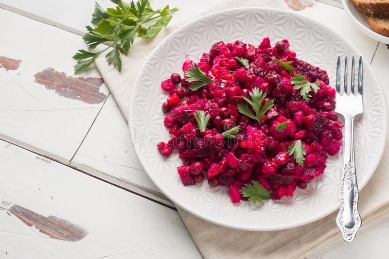 Fresh homemade Beetroot salad Vinaigrette in a white bowl. Traditional Russian food. Copy space. Fresh homemade Beetroot salad Vinaigrette in a white bowl stock photo