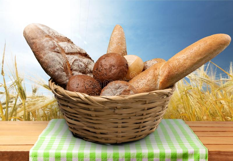 Fresh homemade bread in basket on light background stock images