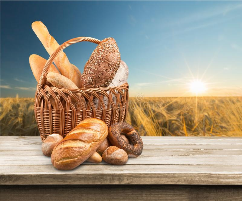 Fresh homemade bread on wooden table stock photos