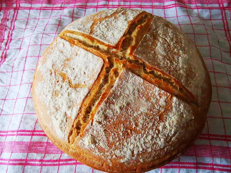 Fresh homemade bread on on a kitchen towel royalty free stock photo