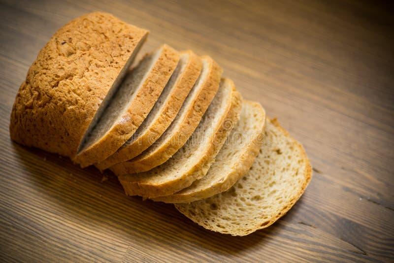 Fresh homemade bread sliced on wooden background stock images
