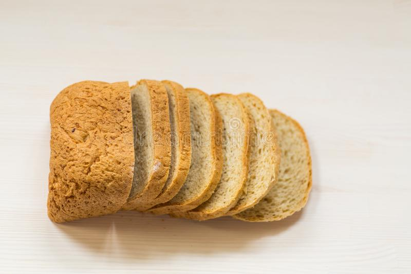 Fresh homemade bread sliced on wooden background royalty free stock images