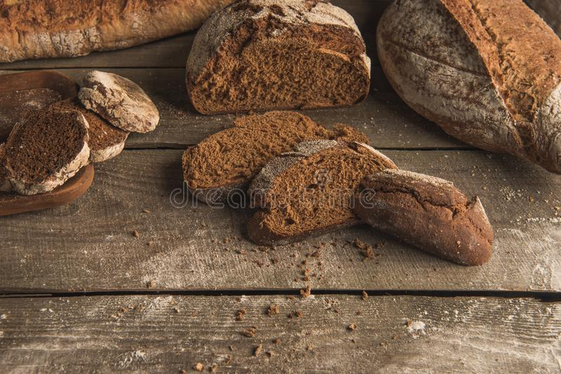 Fresh homemade bread. Top view of sliced and whole loaves of fresh homemade bread on rustic table stock photo