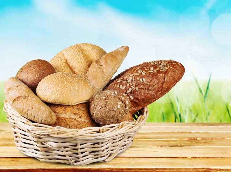 Fresh homemade bread in wicker basket stock images