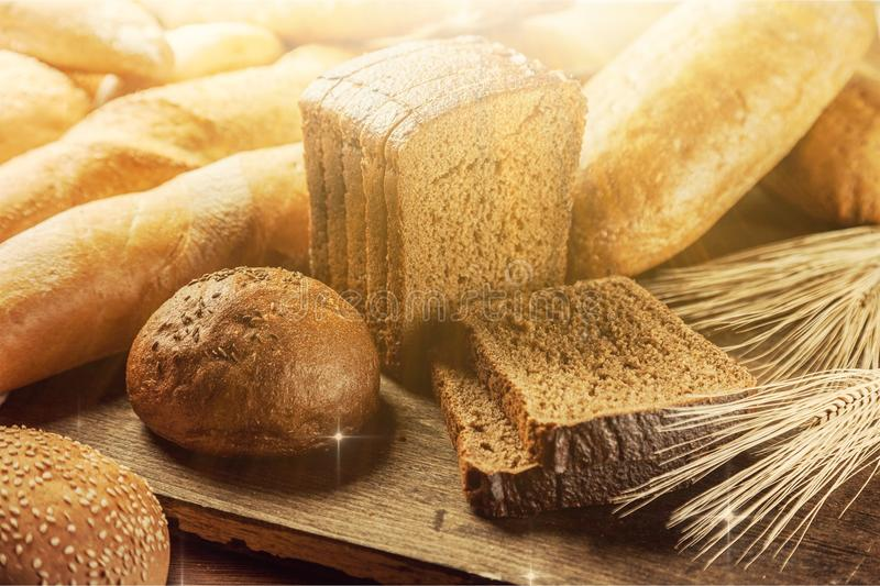 Fresh homemade bread on wooden table royalty free stock image