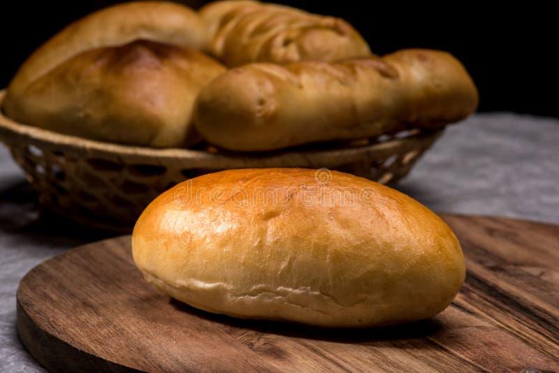 Fresh homemade burger bread buns on dark wood background stock photography