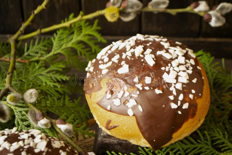 Fresh homemade burger buns with chocolate, dark background royalty free stock photography