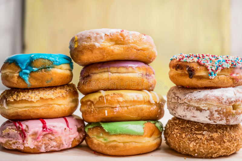 Fresh homemade colorful donuts with icing glaze. Close up royalty free stock image
