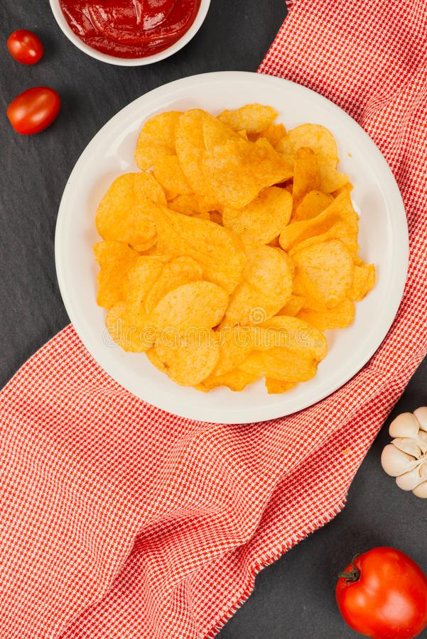 Fresh homemade crispy French fries on balck stone background. Fresh homemade crispy French fries on balck stone background stock photo