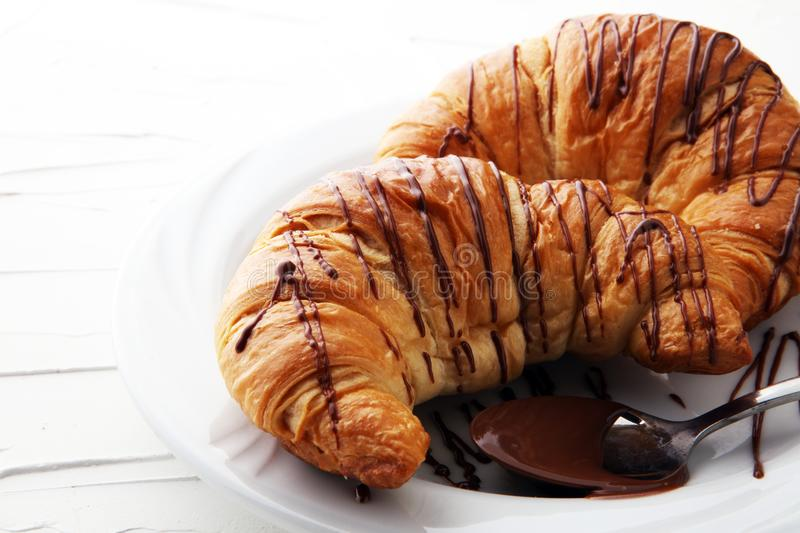 Fresh homemade croissants with chocolate. Sweet bakery concept.  royalty free stock image