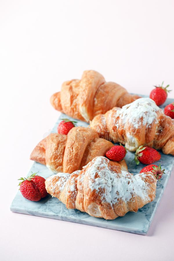 Fresh homemade croissants with strawberry and various toppings. Top view. French bakery concept.  stock image