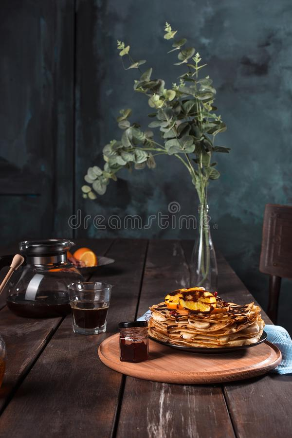 Fresh homemade french crepes made with eggs, milk and flour, filled with marmalade on a vintage plate. Fresh homemade french crepes made with ffresh fruits on a royalty free stock images