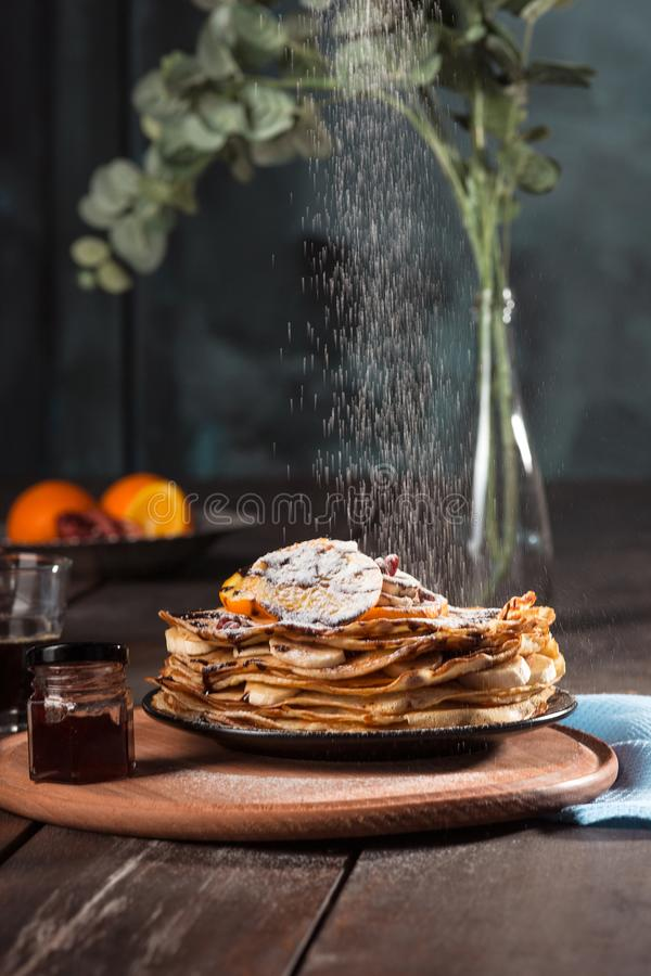 Fresh homemade french crepes made with eggs, milk and flour, filled with marmalade on a vintage plate. Fresh homemade french crepes made with ffresh fruits on a stock photography