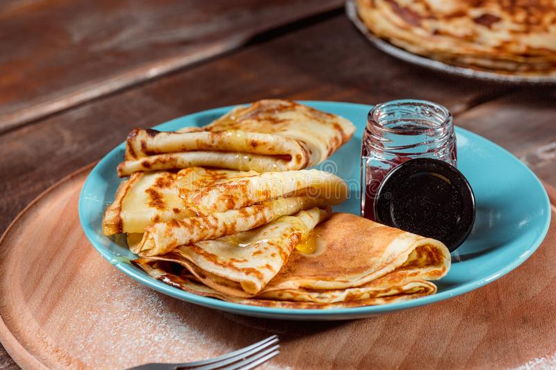 Fresh homemade french crepes made with eggs, milk and flour, filled with marmalade on a vintage plate. Fresh homemade french crepes made with ffresh fruits on a stock images