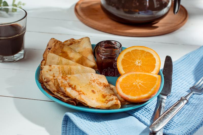 Fresh homemade french crepes made with eggs, milk and flour, filled with marmalade on a vintage plate. Fresh homemade french crepes made with ffresh fruits on a stock image
