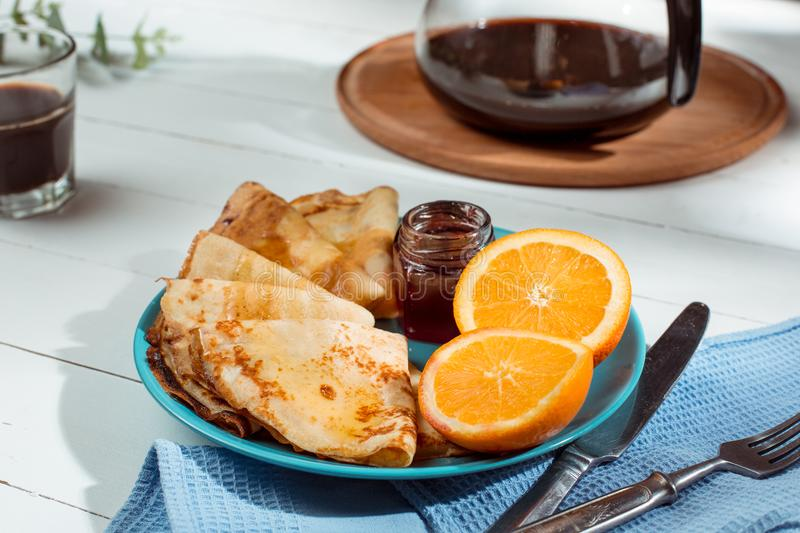 Fresh homemade french crepes made with eggs, milk and flour, filled with marmalade on a vintage plate. Fresh homemade french crepes made with ffresh fruits on a stock photos