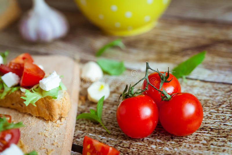 Fresh homemade Italian bruschetta. Cherry tomatoes close view royalty free stock photography