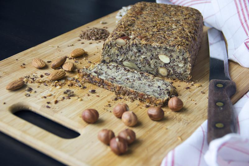 Fresh homemade keto bread with almonds, hazelnuts, sunflower seeds, chia seeds royalty free stock photography