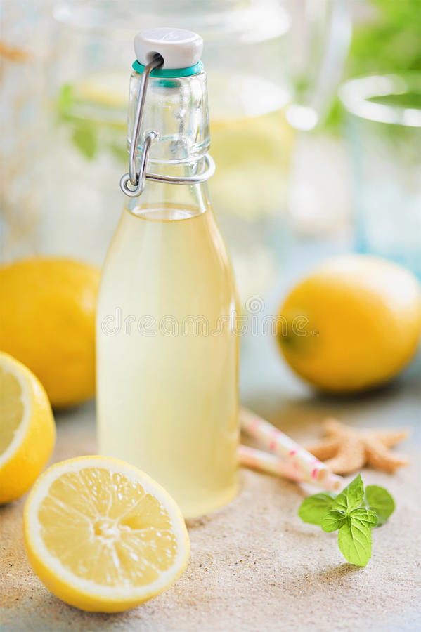 Fresh homemade lemonade. Homemade lemon syrup and fresh lemonade royalty free stock photos